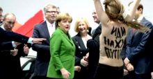 Merkel-Putin attaccati dalle Femen a seno nudo